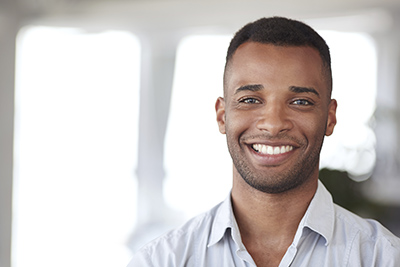 Young Man with Beard Stubble Smiling iStock 000078214675 width of 400 pixels