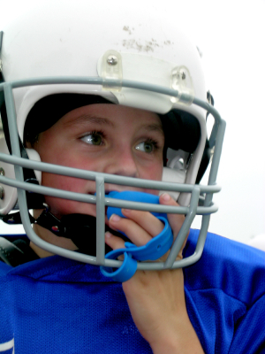 Young boy wearing football helmet with mouthguard  sports  kids